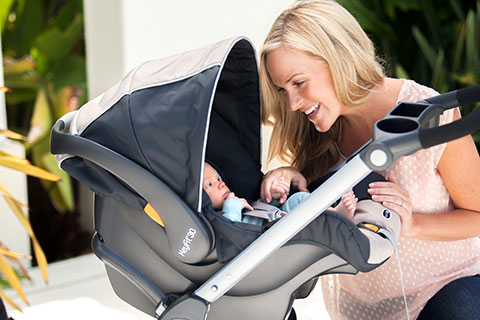 Mom smiling at baby in Chicco Stroller