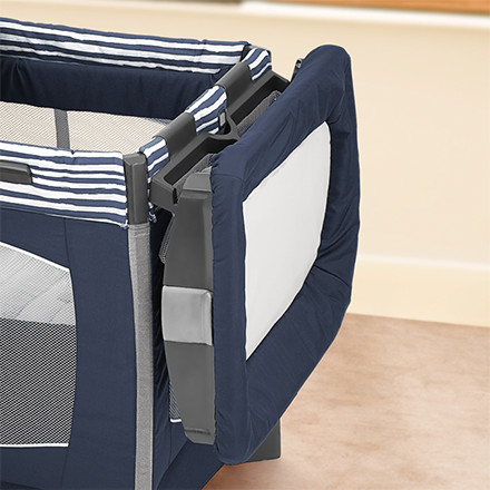 Detachable changer snaps on/off easily and stores on the side of playard